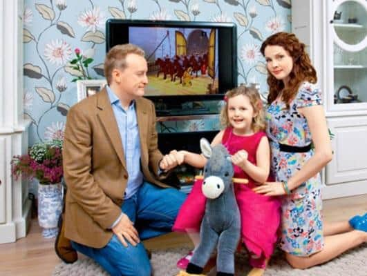 Екатерина Вуличенко с мужем и ребенком