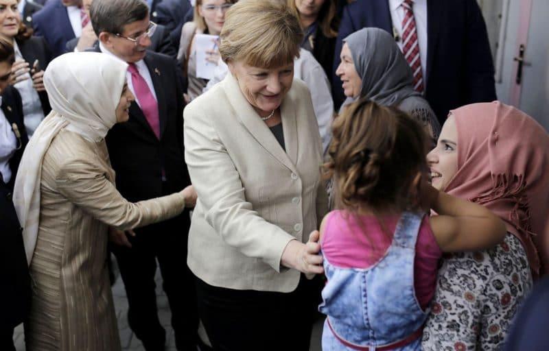 Ангела Меркель с мигрантами
